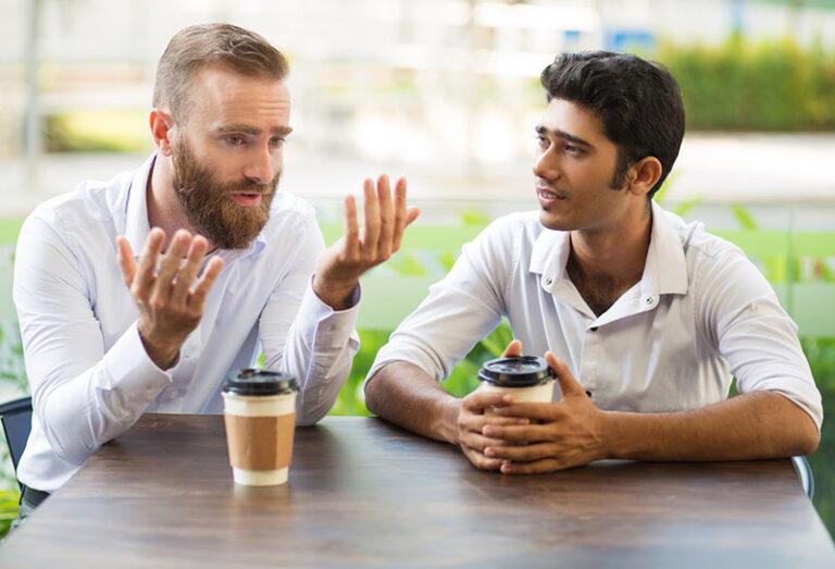 men talking coffee